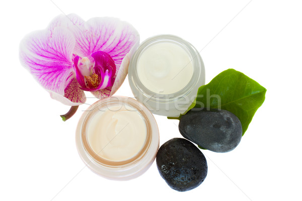 Beauty creams  with orchid and spa stones Stock photo © neirfy