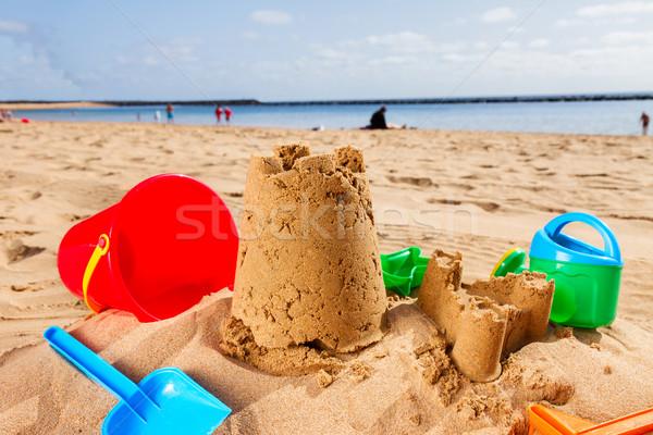 Homokvár tengerparti homok kastély műanyag játékok napos Stock fotó © neirfy