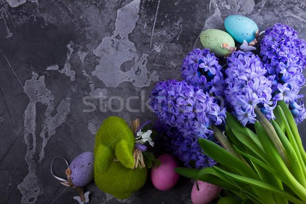 Pasen scène gekleurde eieren lentebloemen konijn exemplaar ruimte Stockfoto © neirfy