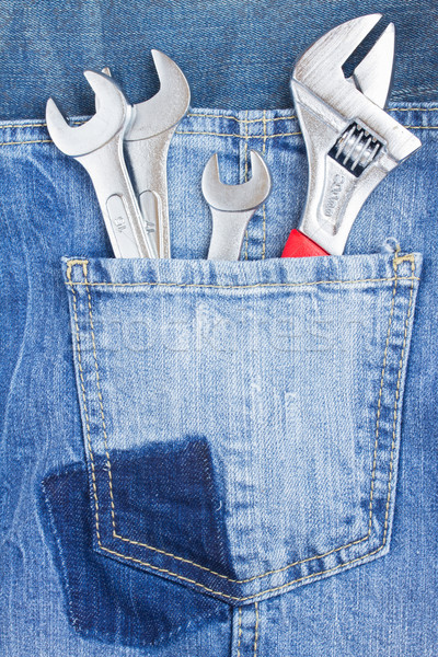 set of spanners in jeans pocket Stock photo © neirfy