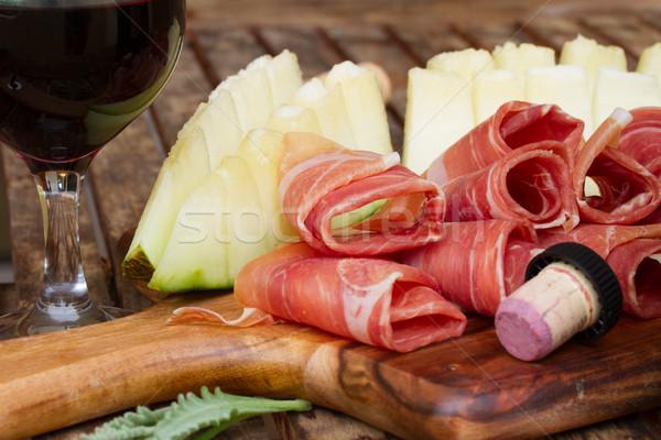 Spanyol tapas szeletek disznóhús sonka dinnye Stock fotó © neirfy