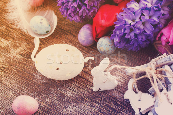 easter eggs with tulips and hyacinth Stock photo © neirfy