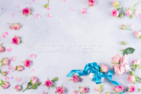 Gift box with satin bow and flowers Stock photo © neirfy