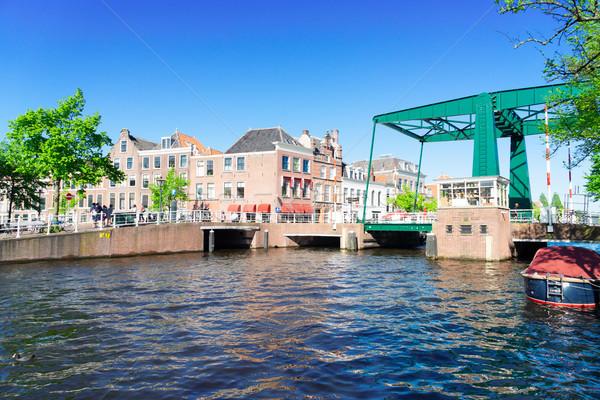 Hollandia híd óváros égbolt víz fa Stock fotó © neirfy