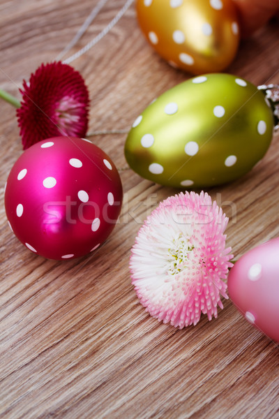 easter eggs with daisy flowers Stock photo © neirfy
