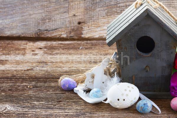 Ovos de páscoa gaiola coelhos tabela páscoa primavera Foto stock © neirfy