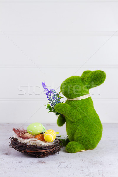 Pasen scène gekleurde eieren nest bunny voedsel Stockfoto © neirfy