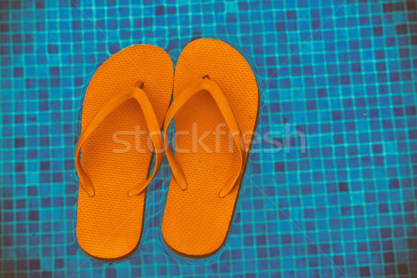 Papucs medence víz narancs lebeg kék Stock fotó © neirfy