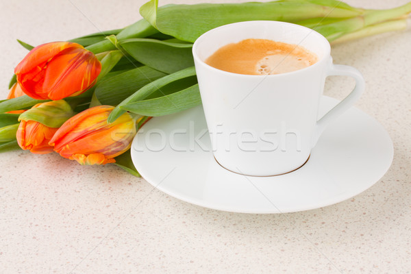 cup of coffee with orange tulips Stock photo © neirfy