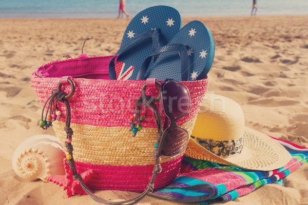 sunbathing accessories on sandy beach Stock photo © neirfy