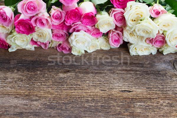 ピンク 白 バラ 新鮮な 国境 木製のテーブル ストックフォト © neirfy