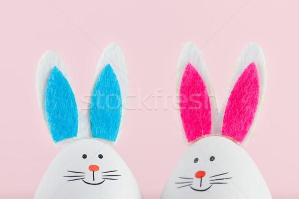 Paskalya sahne renkli yumurta iki komik pembe Stok fotoğraf © neirfy