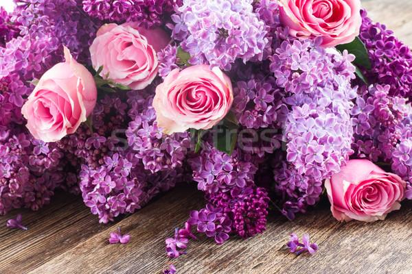 Orgona virágok lila rózsaszín rózsák fa asztal Stock fotó © neirfy