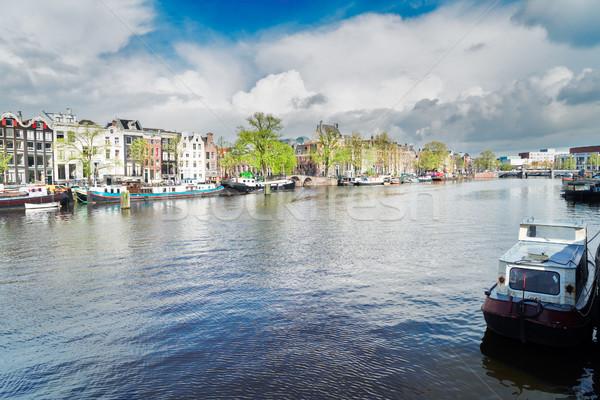 Canal Amsterdam tradicional casas Países Bajos cielo Foto stock © neirfy