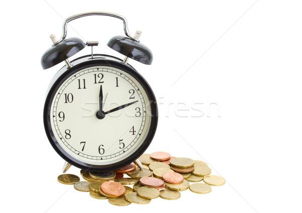 Despertador moedas isolado branco negócio dinheiro Foto stock © neirfy