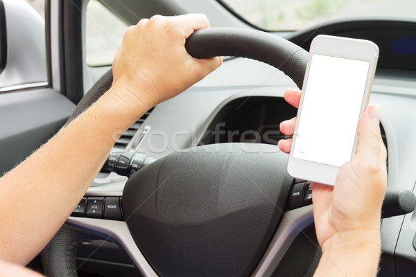 hands driving and  holding a phone with empty  screen Stock photo © neirfy
