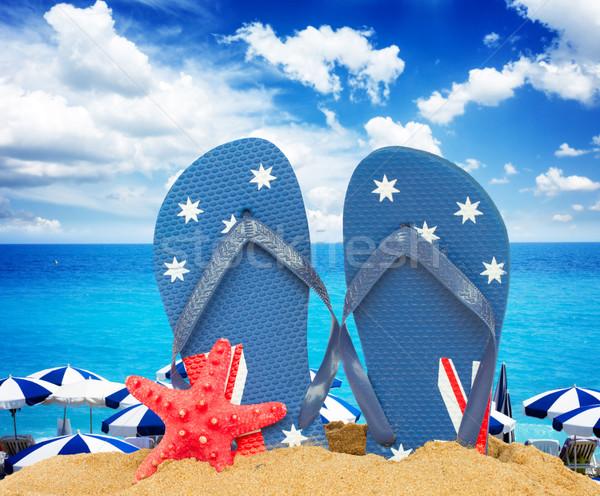 Azul sandalias estrellas de mar arena par fondo Foto stock © neirfy