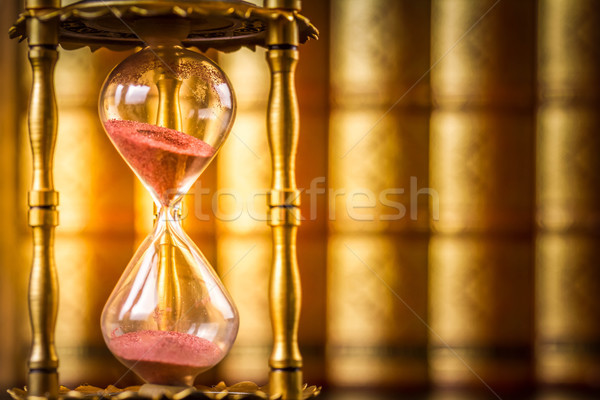 Hourglass with law books in background Stock photo © neirfy