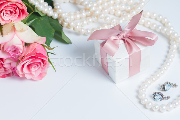 Box with pink ribbon Stock photo © neirfy
