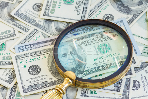 money under manifying glass Stock photo © neirfy