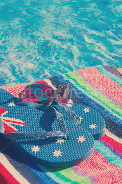 towel and sandals  near pool Stock photo © neirfy