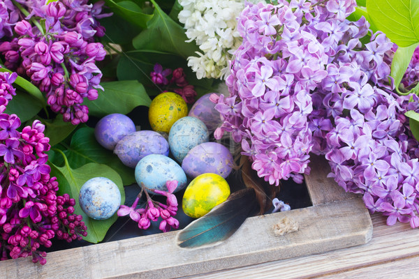 Húsvéti tojások orgona virágok köteg friss virág Stock fotó © neirfy