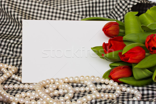 red tulips with pearls strand and blank card Stock photo © neirfy