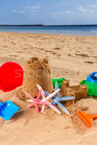 Homokvár tengerparti homok kastély színes műanyag játékok Stock fotó © neirfy