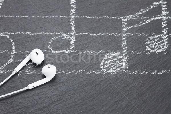 Notas musicales auriculares blanco negro piedra música Foto stock © neirfy
