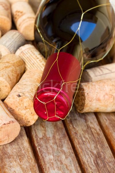 red  wine bottle and corks Stock photo © neirfy