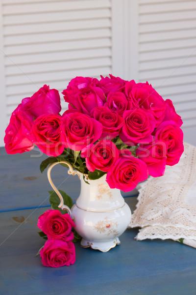 Leylak rengi güller vazo buket mavi Stok fotoğraf © neirfy