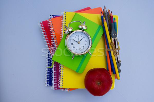 Okula geri çalar saat okul malzemeleri mavi kâğıt okul Stok fotoğraf © neirfy