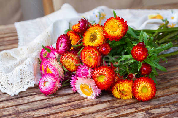 Bouquet of Everlasting flowers on table Stock photo © neirfy