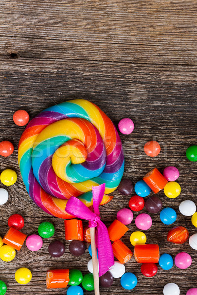 Colorful candies on wood Stock photo © neirfy
