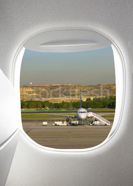 Stock photo: Plane window with airfield