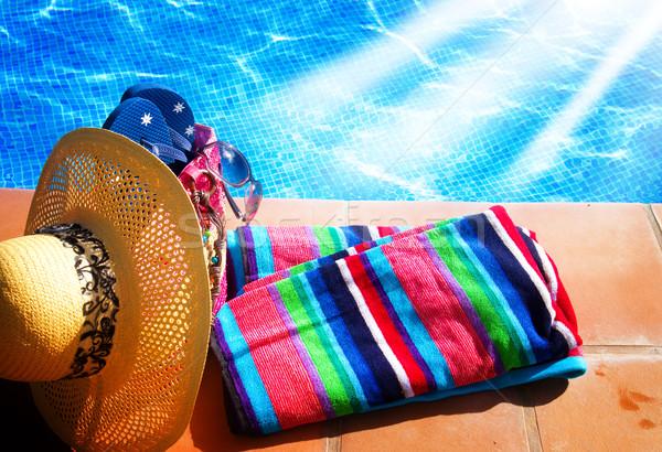 Törölköző fürdik kellékek medence oldal nap Stock fotó © neirfy