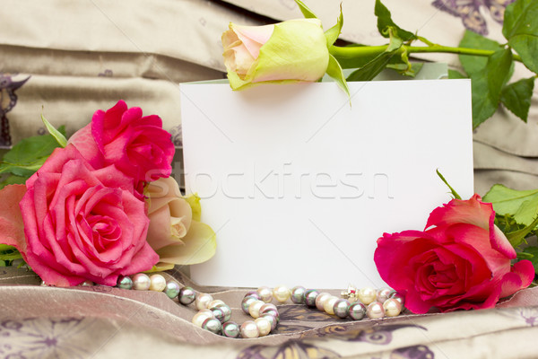 roses with pearls strand and blank card Stock photo © neirfy