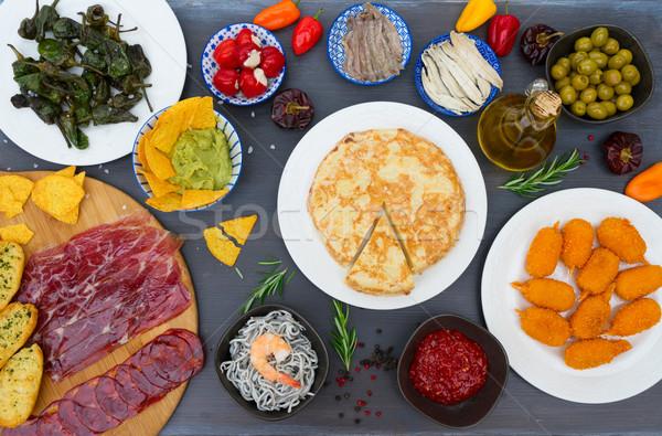 Table with spanish tapas Stock photo © neirfy