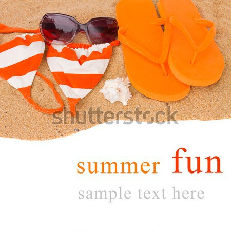 orange flip flops and swimming suit on sand Stock photo © neirfy