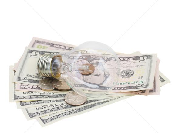 common  lamp bulb on dollars Stock photo © neirfy