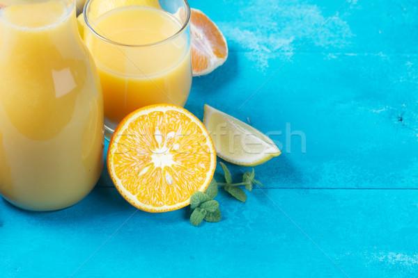 Sinaasappelsap glas Blauw houten tafel hout Stockfoto © neirfy