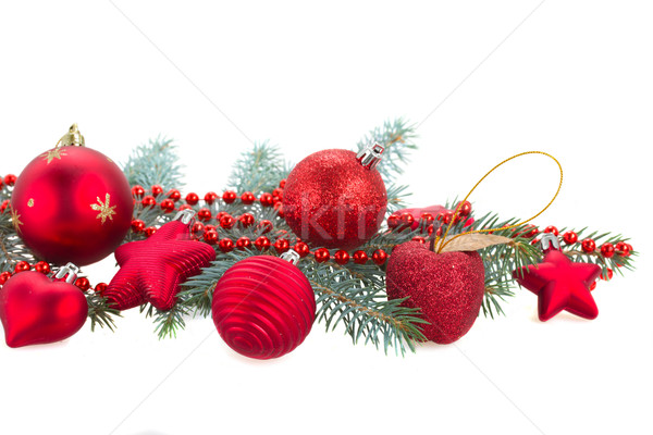 Stock photo: fir tree branch and red  christmas decorations