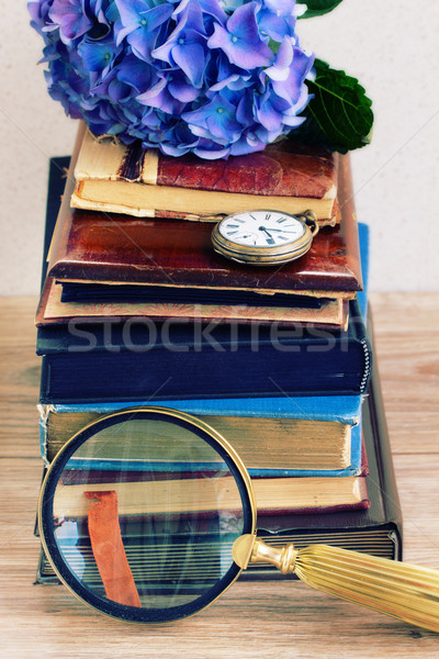 pile of old books with flowers and clock Stock photo © neirfy