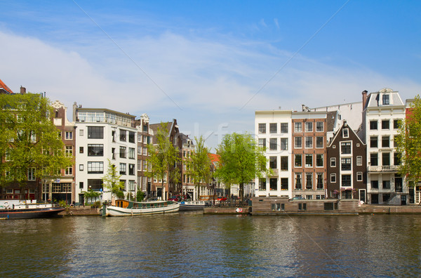 Folyópart Amszterdam öreg házak folyó Hollandia Stock fotó © neirfy
