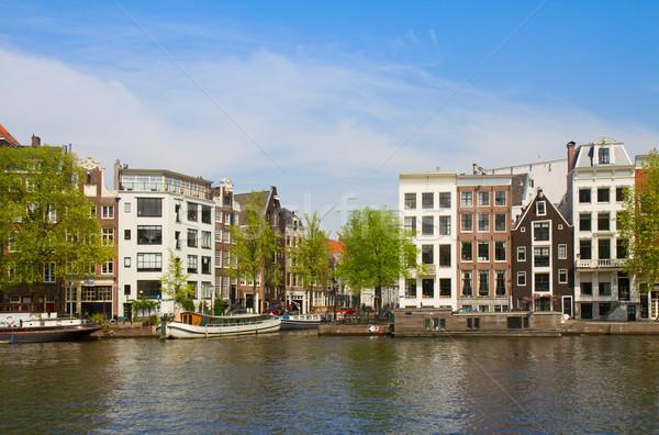 Rivieroever Amsterdam oude huizen rivier Nederland Stockfoto © neirfy