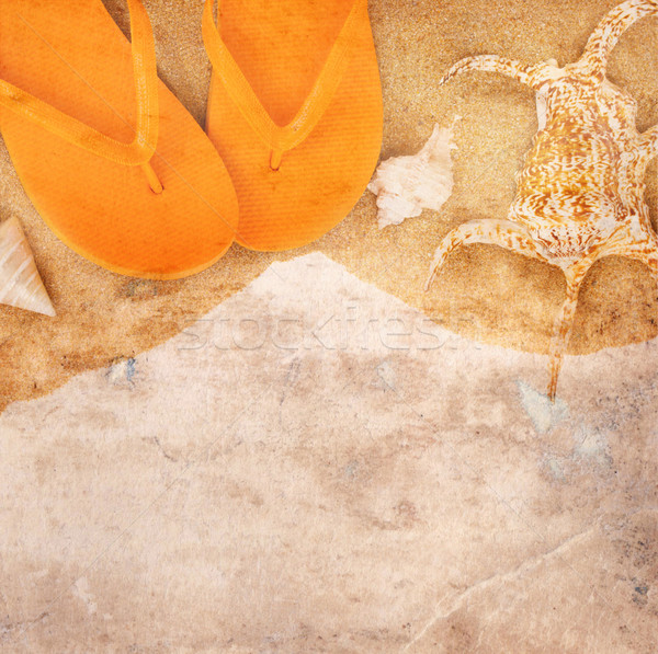 Old paper with sandals on sand Stock photo © neirfy