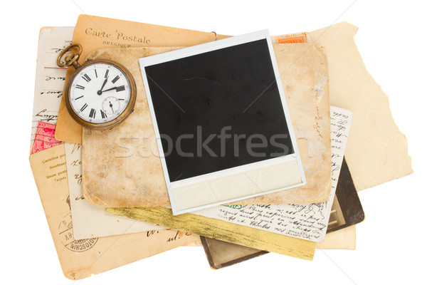 pile of old photos with antique clock Stock photo © neirfy