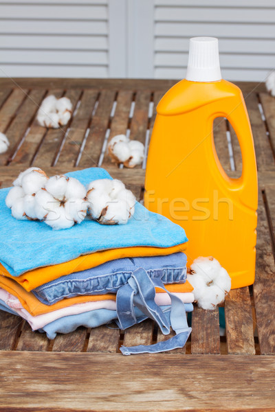 orange bottle of detergent and cotton clothes Stock photo © neirfy