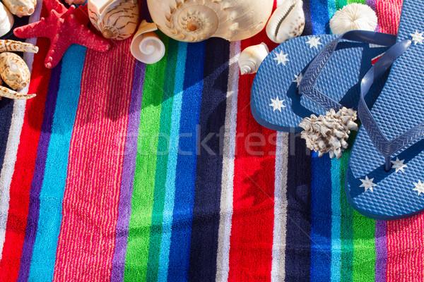 Azul toalla de playa a rayas mar conchas Foto stock © neirfy