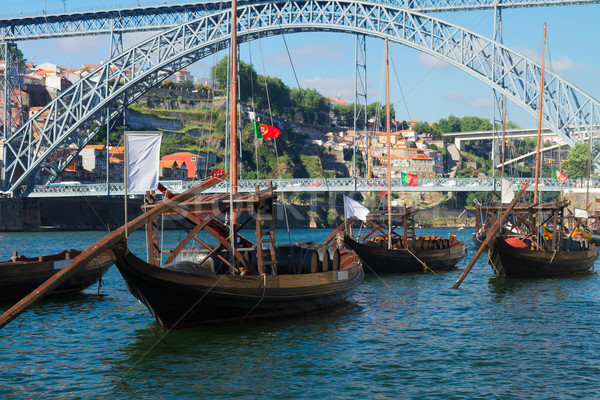 rabelo boats and bridge of Dom Luis , Portugal Stock photo © neirfy